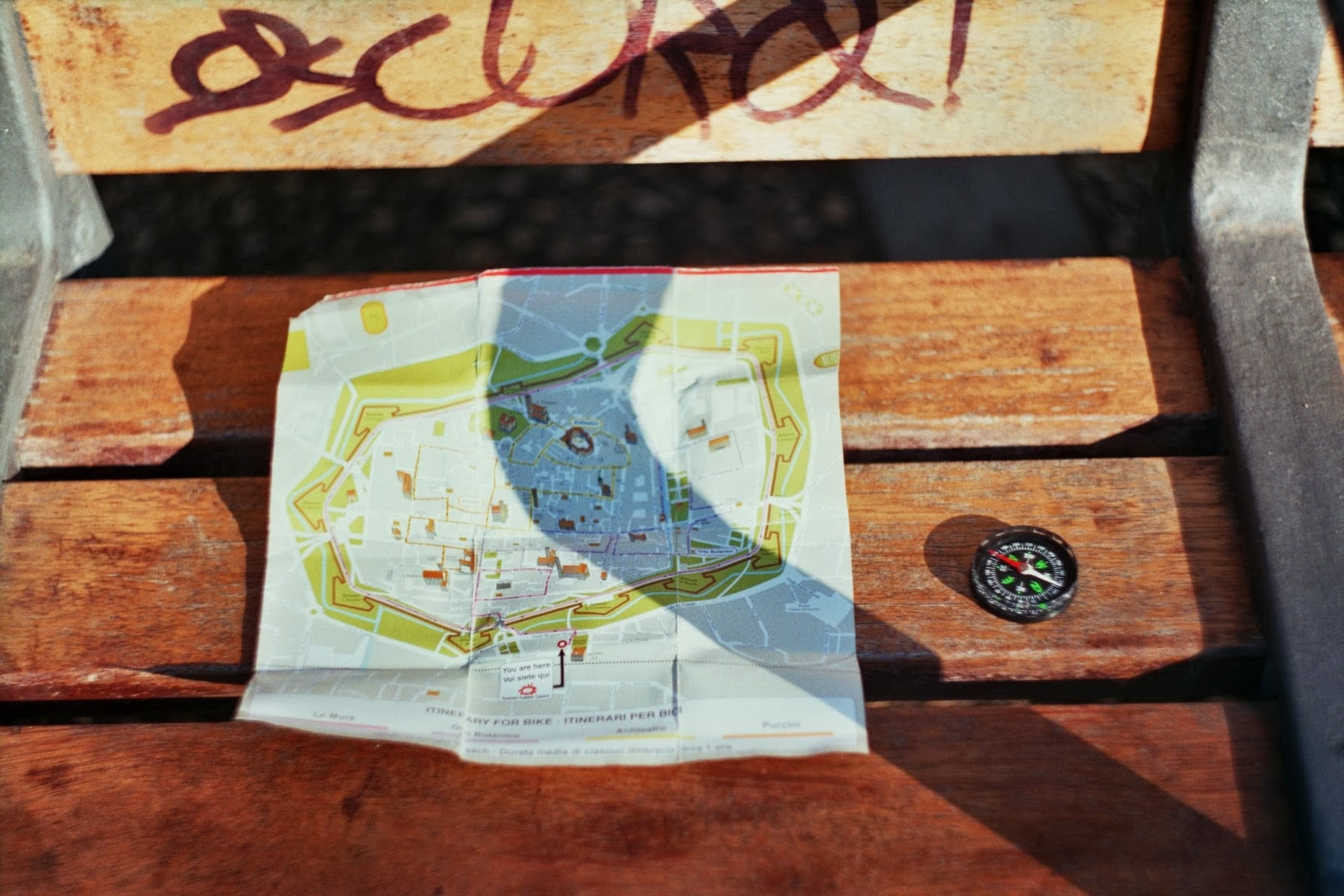 The map of Lucca city and compass
