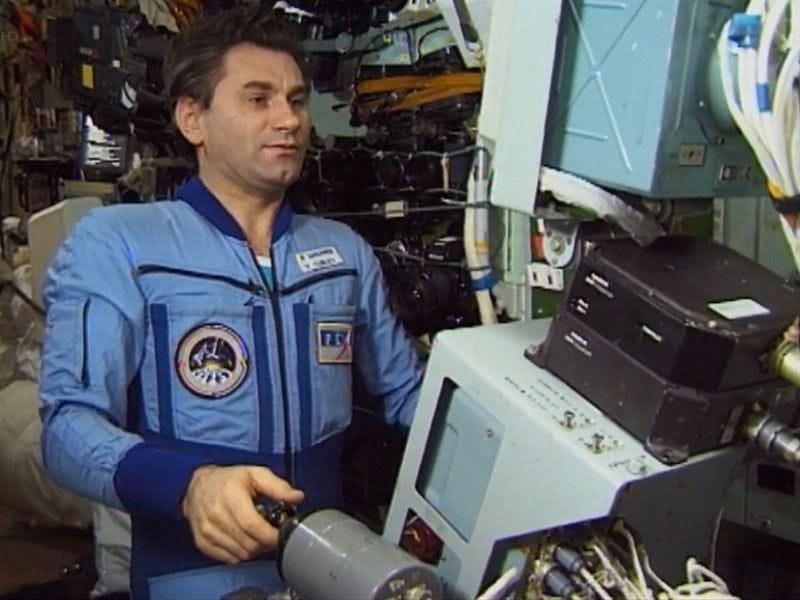 Russian cosmonaut Vasily Tsibliev controlling Progress remotely from Mir